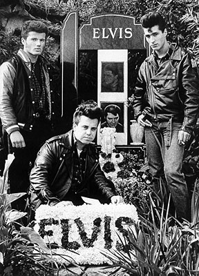 The Young Men Paying Homage to Elvis with Floral Tribute