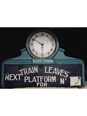 Train indicator board with clock used at Claremont Station.