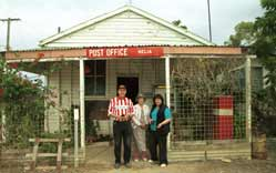 Nelia Post Office - operated by Mrs Alloway (centre) - is the hub of Nelia.