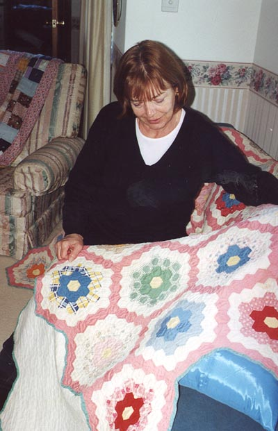 Muriel Thompson with quilt.