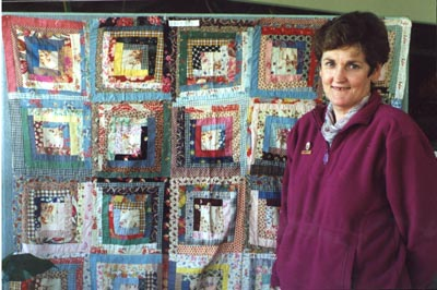 Lois Ryan with quilt