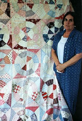 Rhona Dunwoodie with her mother's quilt.