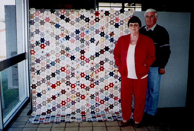 Shirley and Brian Gibb with Alice's quilt top.