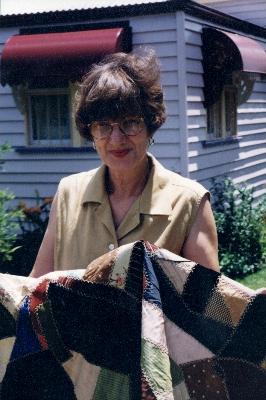 Owner, Bev Edmonds, with quilt