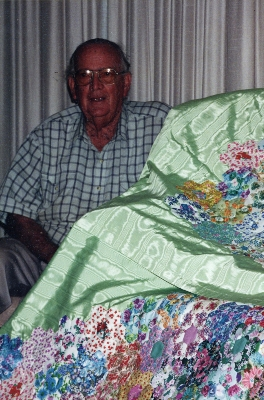 Bill Meynink with his mother's quilt