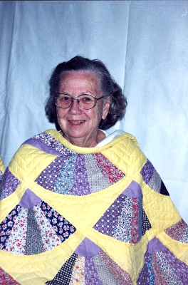 Alyce Wright with her grandmother's quilt 1998