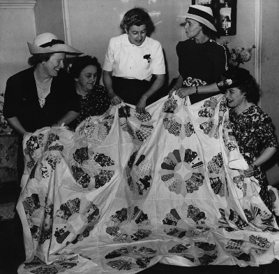 Dorothy McMorran (centre) and members of the Canadian Women's Association. Pix photo 1945