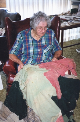 Nancy looking at her baby dress, 2000
