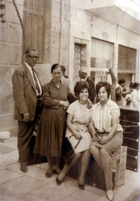 Maria (second from right) with friend and her parents. 1962