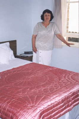 Maria Ahilas with her quilt, 2001