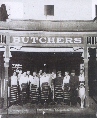 The butcher's shop showing the husband of the maker & their daughter