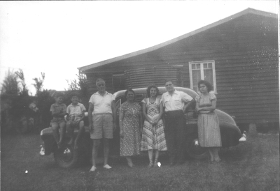 The Efstathis family outside their Queenslander house 1951