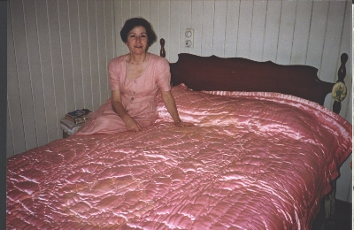 Connie Papalazaros with her quilt, 2000