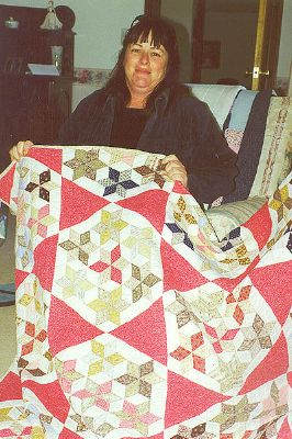 Alison Barlow with quilt.